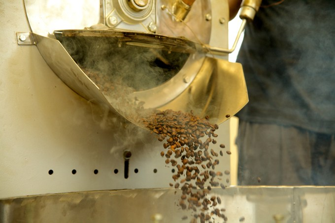 When ready, the roasted beans are dropped from the roasting drum into a cooling vat.