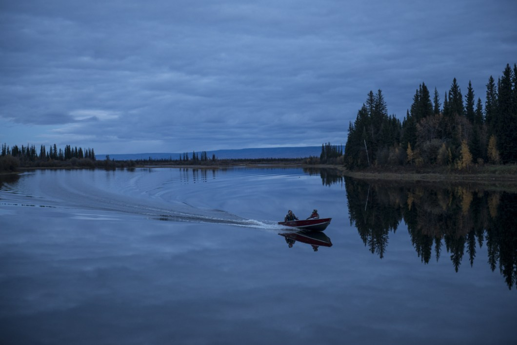 Lloyd Chicot, Chief of Kakisa Dene First Nation, boats to camp on Tathina Lake, NWT with his wife Anita.