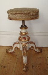 Adjustable, revolving Continental late 19th century piano stool.