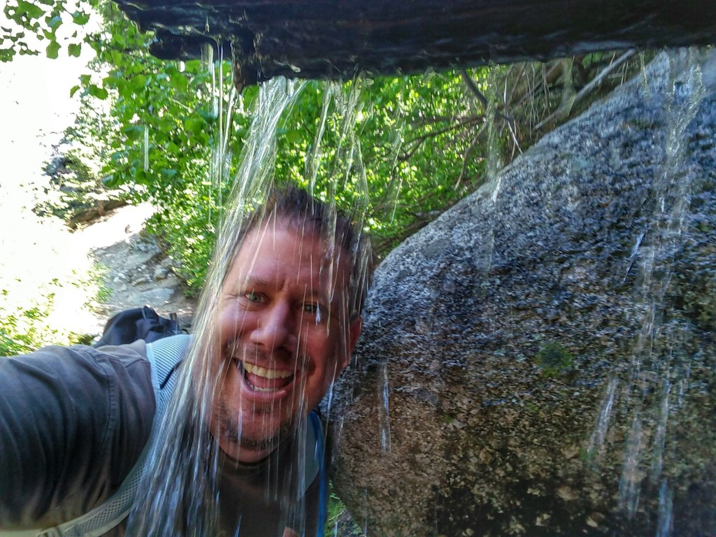 Greg Berndt from Flip Flop Wanderer standing in front a a small waterfall on the side of the trail going to Mt. Whitney. This image is on his About Page.