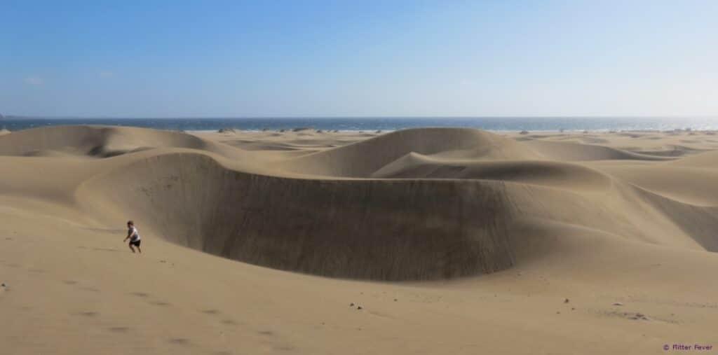 Dunas de Maspalomas Gran Canaria kid playing in sand dunes