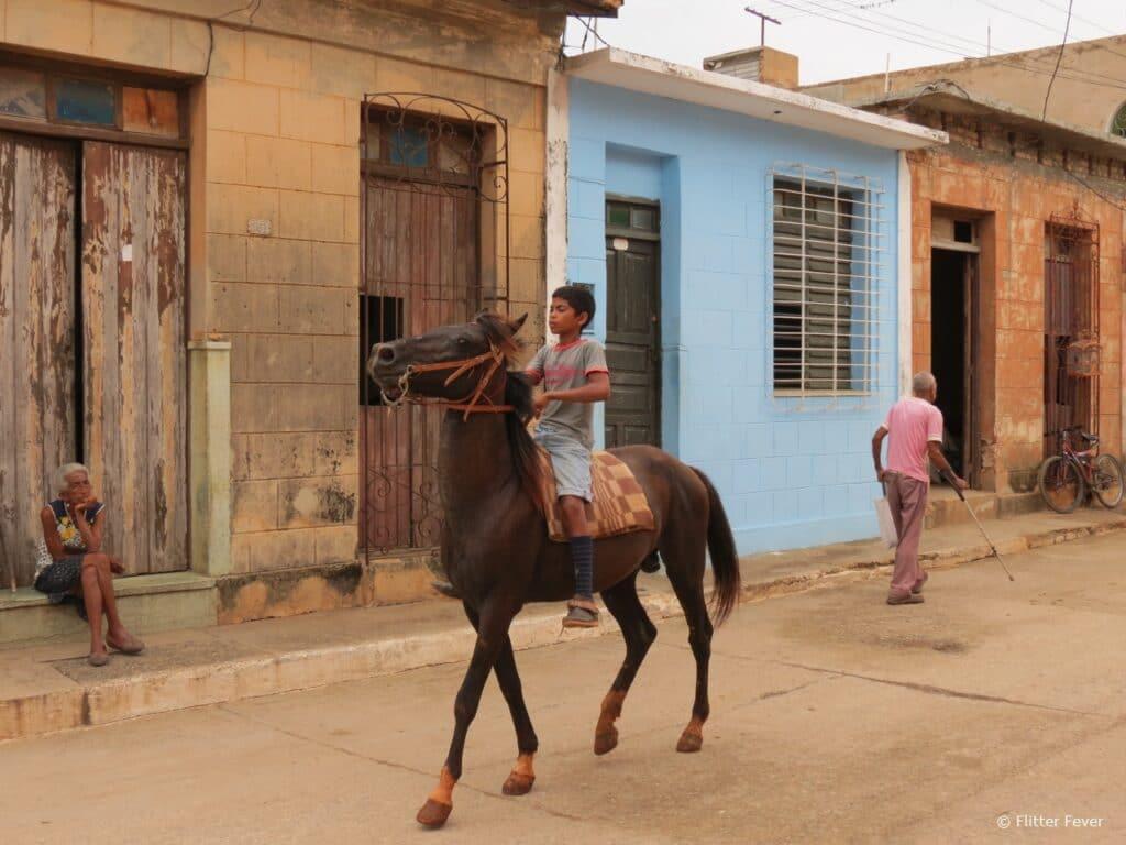 Young boy on horse Trinidad Cuba