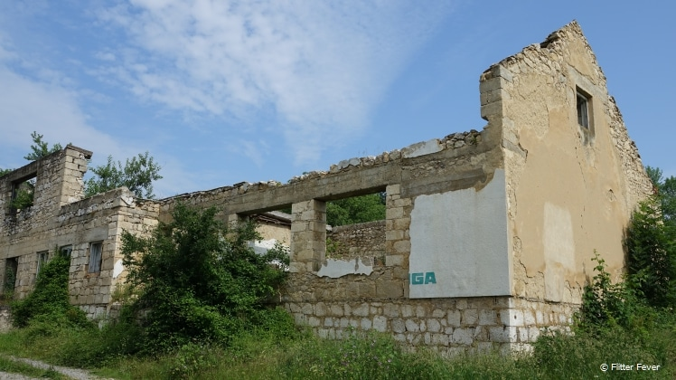 Destroyed and abandoned houses with bullet holes in the walls in Bosnia-Herzegovina