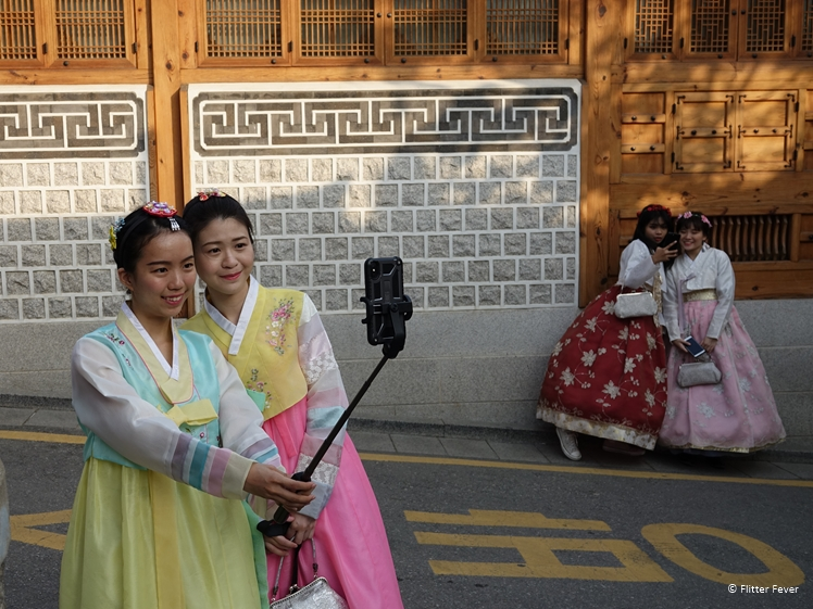 Korean girls taking photos in Seoul