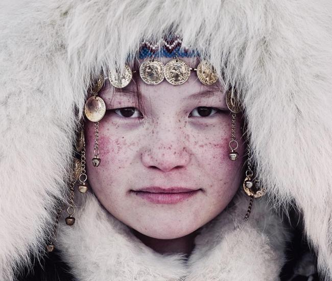 Nenets girl in Russia by Jimmy Nelson