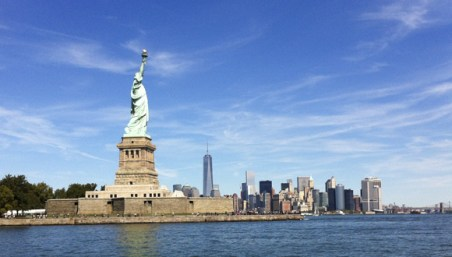 Lady Liberty stands tall on a sunny day