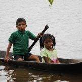 a boy brings his sister from far upriver