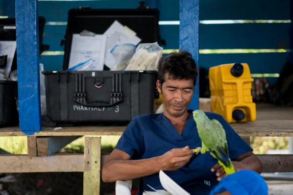 Dr.Luis Takes a Break With the Village Parrot