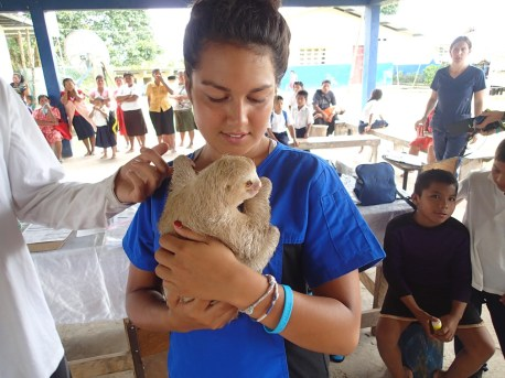 Young Student Holding a Sloth Waiting To See Our Veterinarian