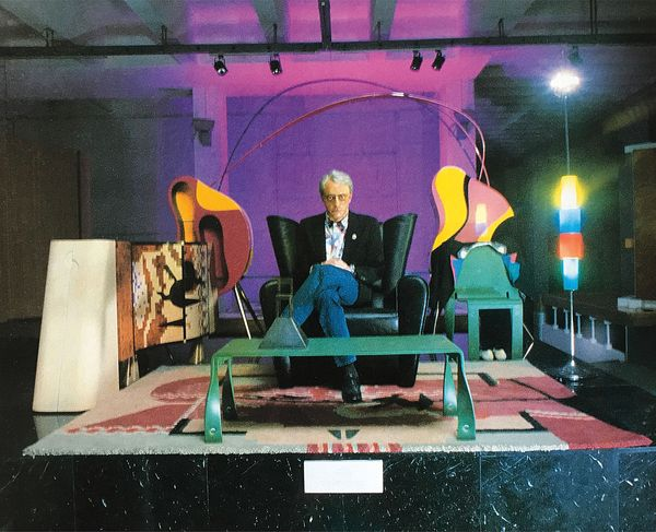 As architect, he designed several buildings, among these the alessi residence in omegna, italy; Alessandro Mendini And Giorgio Gregori At The Xvii Milan Triennale