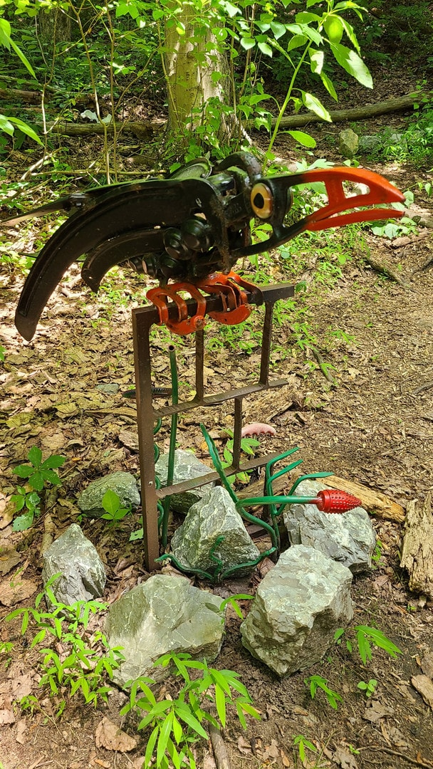 A sculpture of a large crow made out of scrap medal