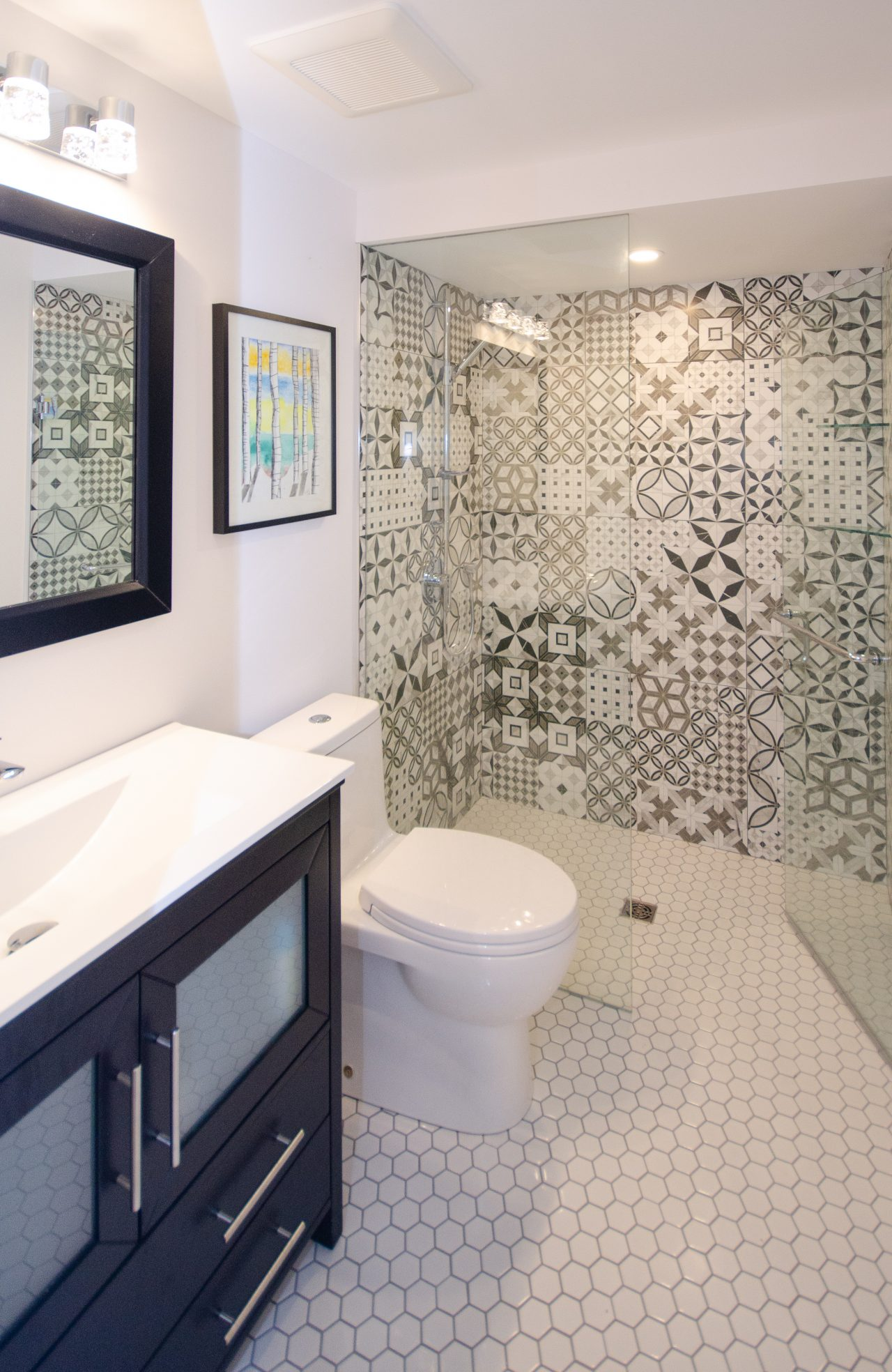 two bathrooms tile accent walls