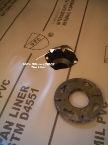 Image of silicone under liner around the drain flange