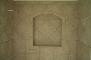 Ceramic niche with arched top and frame. On-point tile throughout