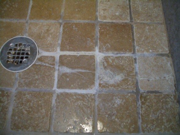 Yup, just substandard tile. No reason to see what's under it...