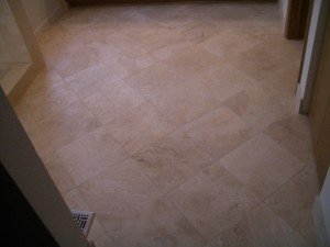 Absolutely flat travertine tile bathroom floor