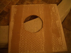 Back of tile with holes cut out