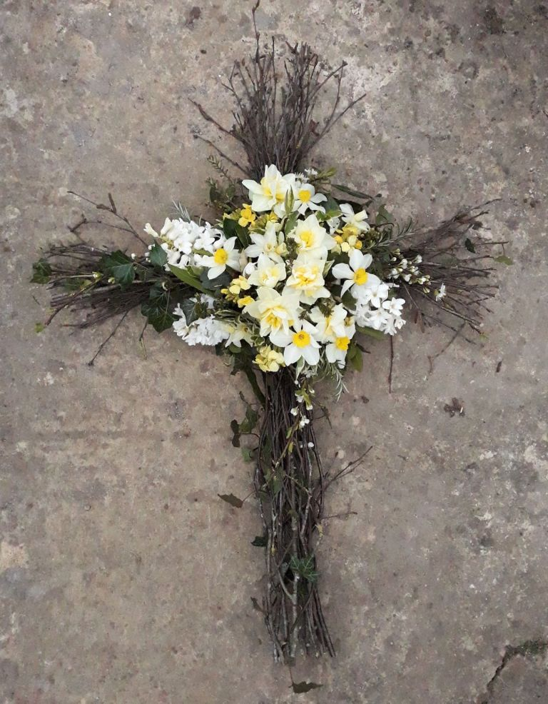 Twiggy funeral cross with spring flowers Floral Acre