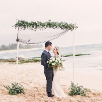 Beach wedding, lots of greenery