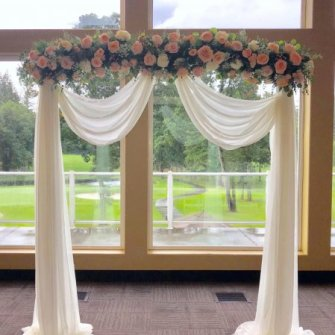 Peaches and cream indoor arbor set-up at Camas Meadows Golf Club