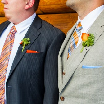mini orange rose with succulents boutonniere