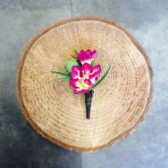 freesia and poppy pod boutonniere
