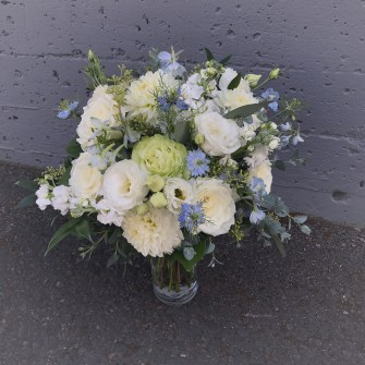 White, light blue, yellow bridal bouquet