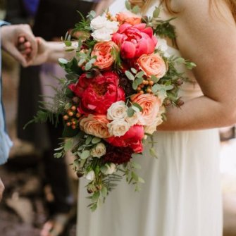 Coral & peaches cascading bouquet with peonies