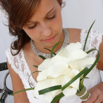 white calla lilies bridal bouquet with subtle lily grass