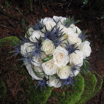White roses with blue sea holly