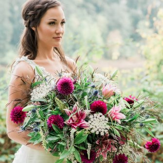 Loose bridal bouquet with dahlias and double lilies