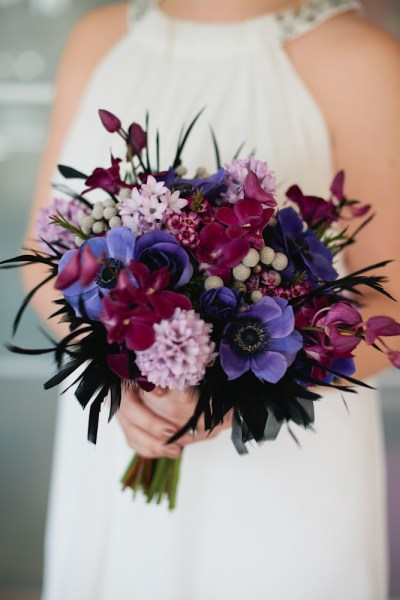 exotic-purple-bridal-bouquet-with-black-feathers