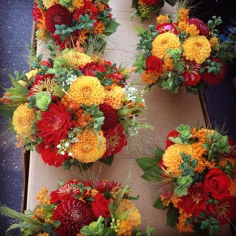 red & orange rustic bouquets