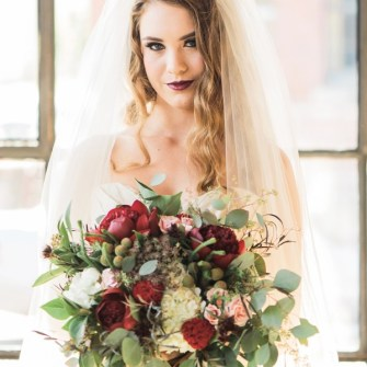 Textured bouquet with burgundy peonies and eucalyptus