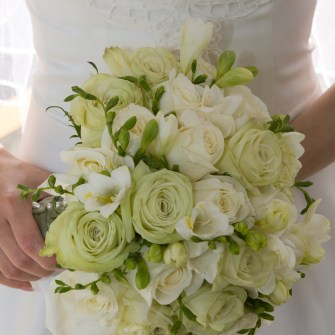 white and green bridal bouquet with green tea roses and white fragrant fresia