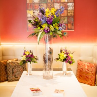 tall floral arrangement with 2 shorter arrangements