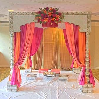 golden white mandap with magenta & orange
