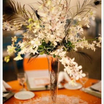 orchids and peacock feathers tall centerpiece