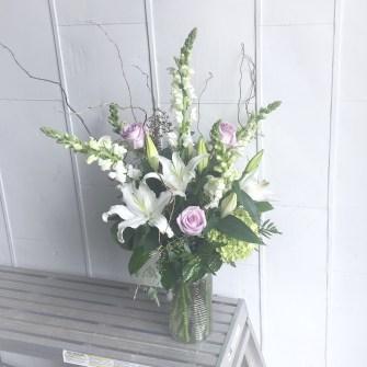 Sympathy arrangement in vase