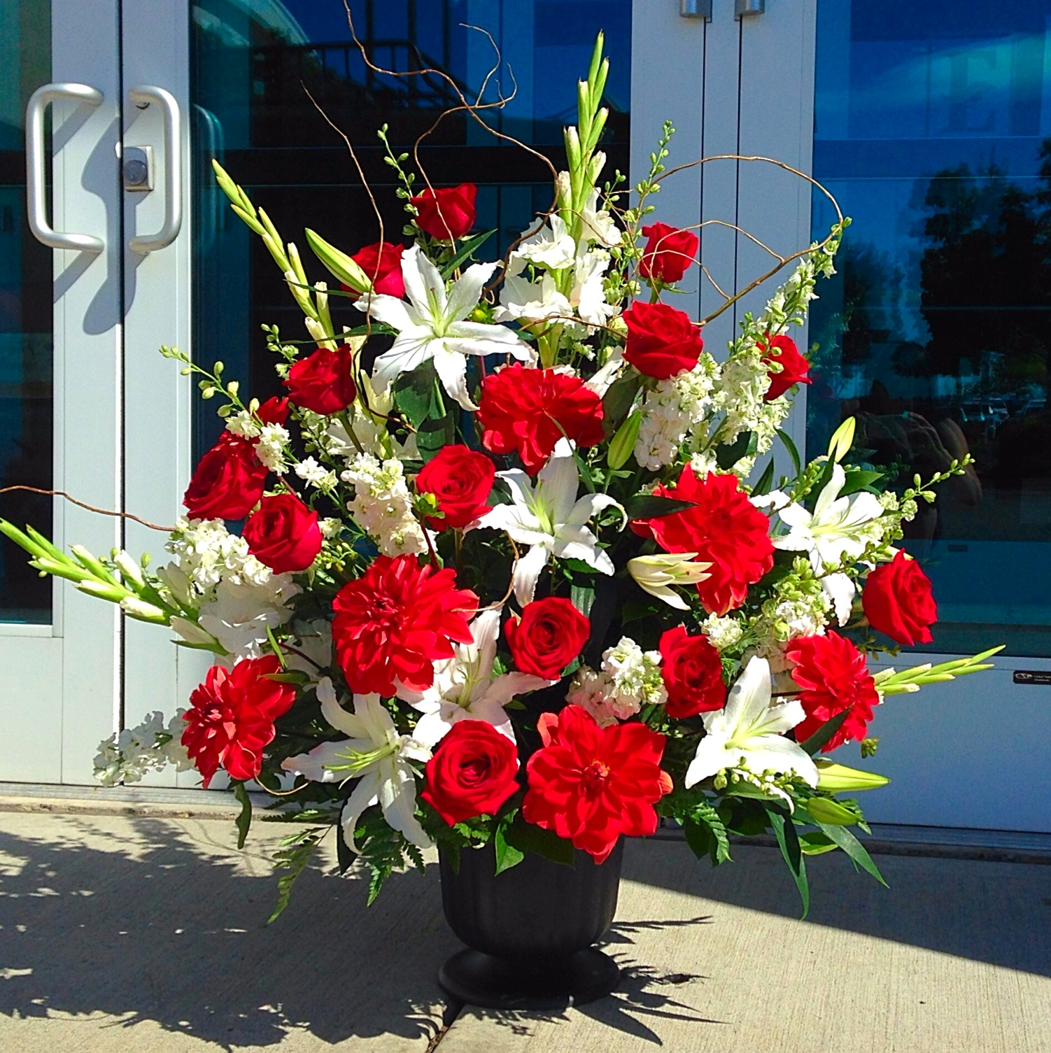 Flower arrangements gallery floral sunshine large red white urn arrangement mightylinksfo