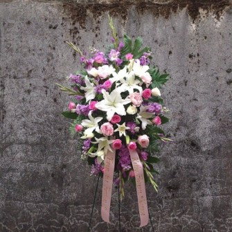 Pastel standing spray with lilies, roses
