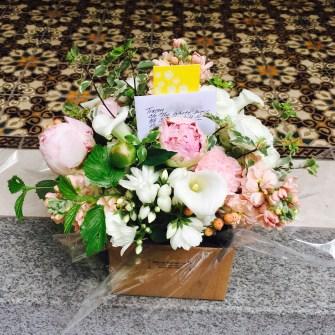 medium romantic arrangement of white calla lilies, pink peonies