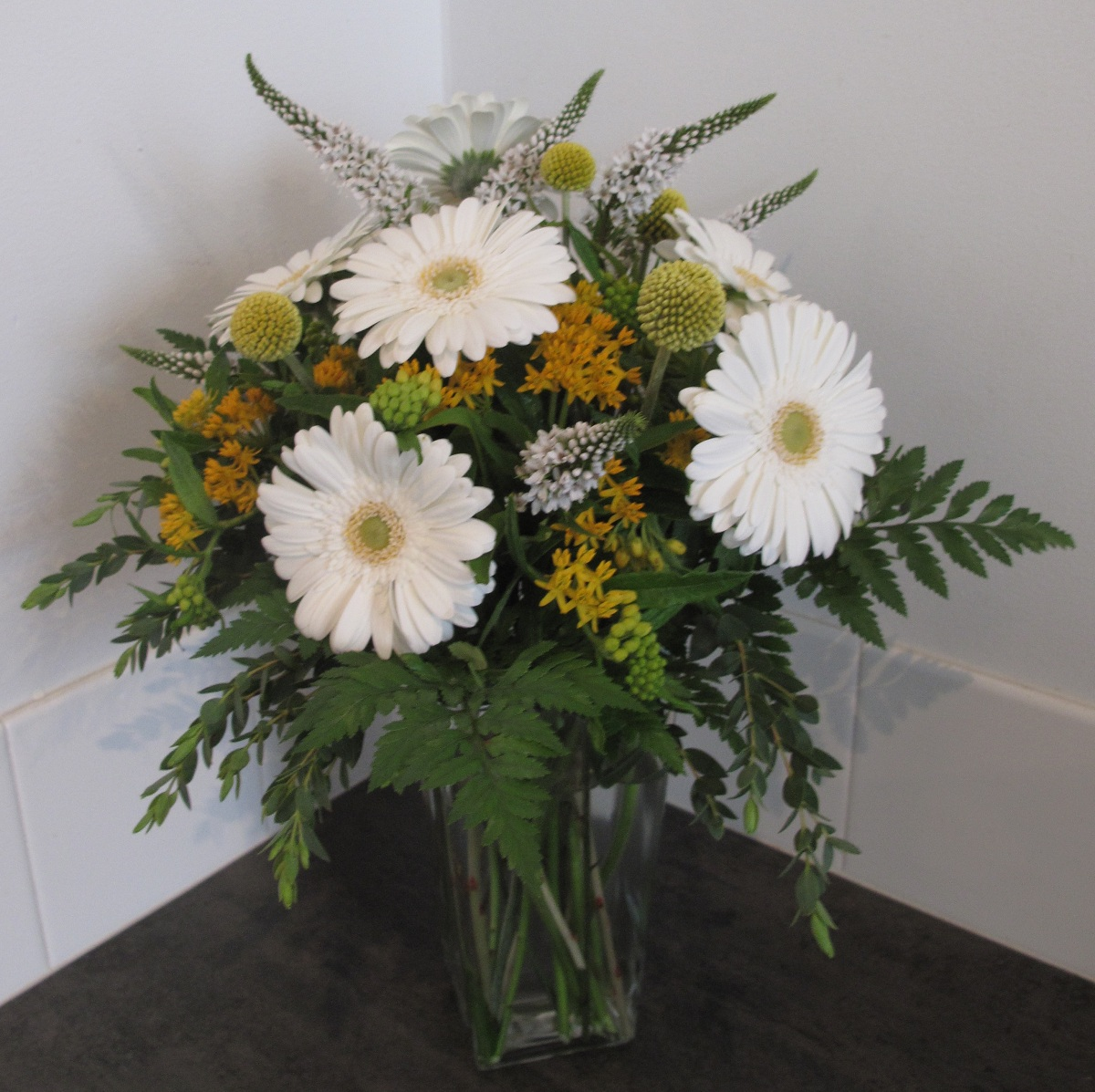 Flower arrangements gallery floral sunshine happy go lucky white gerbera daisy billy balls asclepsia floral medium arrangement izmirmasajfo