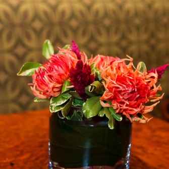 Small tropical arrangement of local spikey dahlias & celosia