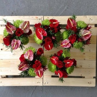 Small green & red holiday tropical arrangement