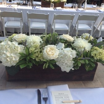 neutral palette of flowers in long wooden boxes
