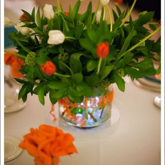 wild orange and white tulips in wedding centerpiece