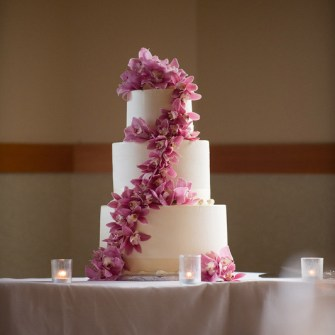 abundant orchids on a simple white cake