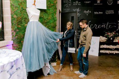 guests examining the bespoke wedding dress by chantel lauren