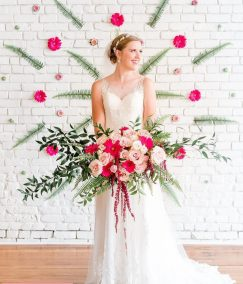 pink and white bridal bouquet with a floral mandala on the wall